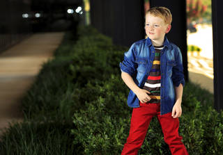 Jude wears Mayoral skinny pants, striped T-shirt, chambray shirt with elbow patches and Toms shoes from Uptown Kids. Photo by Chris Landsberger, The Oklahoman CHRIS LANDSBERGER