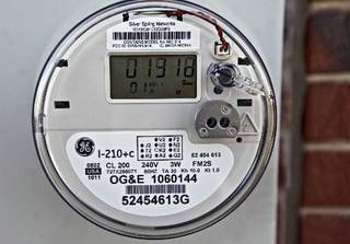 An Oklahoma Gas and Electric Co. smart meter on a home in Piedmont in January. Photo by Chris Landsberger, The Oklahoman archives