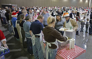 Volunteers serve at the Red Andrews Christmas Dinner on Sunday, Dec. 25, 2011, in Oklahoma City, Okla. Photo by Steve Sisney, The Oklahoman STEVE SISNEY - THE OKLAHOMAN