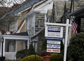 A sale pending sign is seen in the front yard of a home in Mt. Lebanon, Pa. AP Photo
