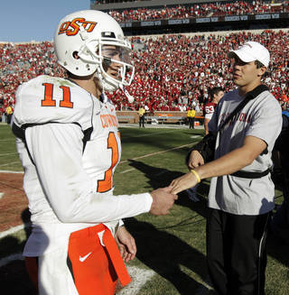 OSU quarterback Zac Robinson (11) talks with OU's Sam Bradford after the Bedlam college football game between the University of Oklahoma Sooners (OU) and the Oklahoma State University Cowboys (OSU) at the Gaylord Family-Oklahoma Memorial Stadium on Saturday, Nov. 28, 2009, in Norman, Okla. OU won, 27-0. Photo by Nate Billings, The Oklahoman