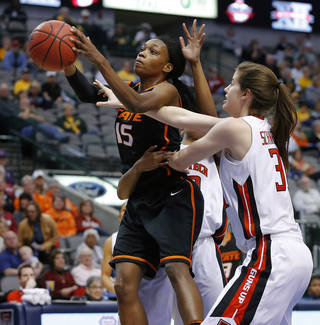 Oklahoma State's Toni Young (15) goes past Texas Tech's Haley Schneider (31) and Jackie Patterson (42) during the Big 12 tournament women's college basketball game between Oklahoma State University and Texas Tech University at American Airlines Arena in Dallas, Saturday, March 9, 2012. Oklahoma State won 59-54. Photo by Bryan Terry, The Oklahoman