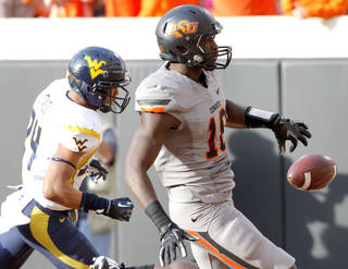 Oklahoma State's Blake Jackson (18) scores a touchdown in front of Oklahoma State's Miketavius Jones (24) in the second quarter during a college football game between Oklahoma State University (OSU) and the West Virginia University at Boone Pickens Stadium in Stillwater, Okla., Saturday, Nov. 10, 2012. Photo by Sarah Phipps, The Oklahoman