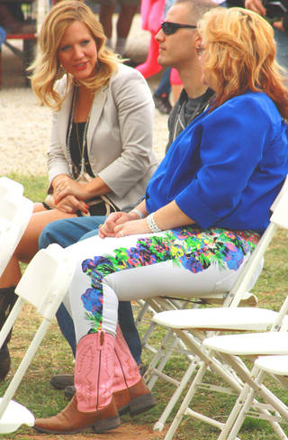 Jacque Posey, left, chats with her husband, Brandon Posey, and her mother, Debie Sharp, after being named the winner in the 2013 Rose Rock Idol competition, a part of this year's Rose Rock Music Festival in Noble. BY LYNETTE LOBBAN, FOR THE OKLAHOMAN