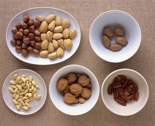 Nuts in bowls Creatas Images -