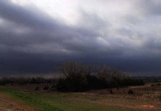 Dark skies on the south edge of Woodward on Tuesday morning. Photo by Jim Beckel