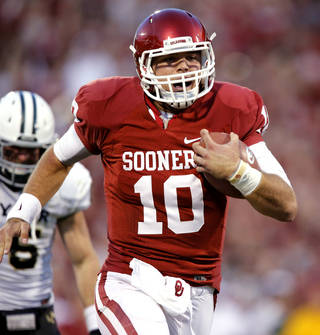 Oklahoma Sooner quarterback Blake Bell (10) takes off on a touchdown keeper during the the second half of the college football game where the University of Oklahoma Sooners (OU) defeated the Baylor University Bears (BU) 42-34 at Gaylord Family-Oklahoma Memorial Stadium in Norman, Okla., Saturday, Nov. 10, 2012. Photo by Steve Sisney, The Oklahoman
