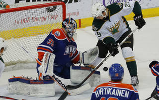Yann Danis of the Oklahoma City Barons deflects the puck away as Alex Chiasson of the Texas Stars tries to score during an AHL hockey game at the Cox Convention in Oklahoma City, Friday, Dec. 21, 2012. Photo by Bryan Terry, The Oklahoman