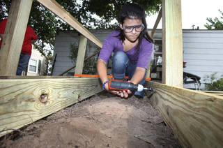 Elizabeth Escobar, 12, of Lexington, works on a ramp as part of Youth Force Cleveland County, a mission project hosted by Goodrich Memorial United Methodist Church in Norman. PHOTO BY DAVID MCDANIEL, THE OKLAHOMAN David McDaniel