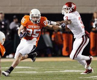 OSU's Josh Cooper (25) takes a reception past OU's Jonathan Nelson (3) during the 2010 Bedlam football game. The Bedlam football game is moving to December for the 2011 season. Photo by Nate Billings, The Oklahoman NATE BILLINGS