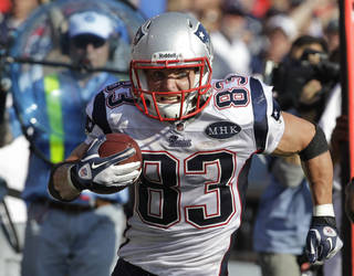 New England Patriots' Wes Welker (83) signed his franchise tender Tuesday with the Patriots. (AP Photo/David Duprey, File) ORG XMIT: NY151