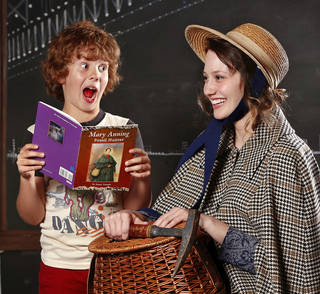 """Nathan Fergeson reacts with surprise when he discovers the woman next to him (A'Mari Rocheleau) is the famed fossil hunter in the book he is reading. The scene is from the Jewel Box Theatre production of """"Excavation."""" Photo by Jim Beckel, The Oklahoman"""