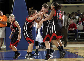 Frontier celebrates their state championship over Okarche in the girl's Class A state basketball tournament between Okarche and Frontier at the State Fair Arena in Oklahoma City, Saturday, March 3, 2012. Photo by Sarah Phipps, The Oklahoman