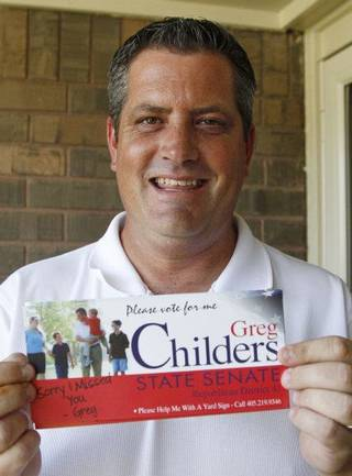 Greg Childers poses with campaign literature outside his home in Del City, Okla., Monday, Aug 8, 2011. Childers and Theresa Nelson, of Oklahoma City, are seeking the Senate District 43 seat being vacated by Republican Jim Reynolds, who stepped down earlier this year to become Cleveland County treasurer. The winner of Tuesday's primary will face Democrat Kenneth Meador of Moore in an Oct. 11 special general election. (AP Photo/Sue Ogrocki) ORG XMIT: OKSO109