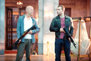"""Bruce Willis as John McClane, left, and Jai Courtney, as his son Jack, in """"A Good Day to Die Hard."""" 20th CENTURY FOX PHOTO"""
