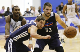 Oklahoma City Thunder's Michael Stockton, front left, and Mitch McGary (33) go after a loose ball in front of Brooklyn Nets' Marquis Teague, left, during an NBA summer league basketball game in Orlando, Fla., Monday, July 7, 2014. (AP Photo/John Raoux)