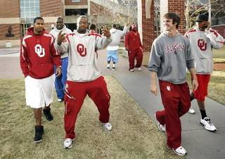 University of Oklahoma football players including Gerald McCoy (gesturing) and Joey Halzle (second from right) leave the Switzer Center after watching results of the Bowl Championship Series ranking in Norman, Oklahoma on Sunday, November 30, 2008. Photo by Steve Sisney