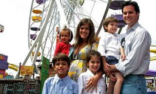 The Humphreys family right to left: Grant, Jack, Emma, Jenifer, Mary, and Ford from Oklahoma City pose in front of the Pacific Park Ferris Wheel on the Santa Monica Pier on Sunday, May 4, 2008 in Santa Monica, Calif. Grant Humphreys placed the winning bid on eBay $132,400 for the Pacific Wheel with plans to bring it home to Oklahoma City. (AP Photo/Stefano Paltera
