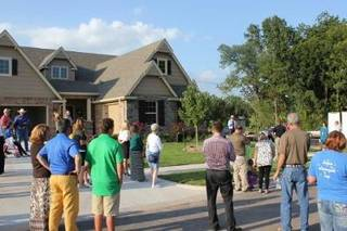 People attend a fund-raising auction for Make-A-Wish of Oklahoma recently in Broken Arrow. PHOTO PROVIDED