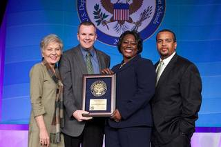 The U.S. Education Department recognized Edmond Santa Fe High School as a National Blue Ribbon School. Accepting the award in Washington, were, from left, Santa Fe teacher Terri McGill, Santa Fe Principal Jason Hayes, Director of the National Blue Ribbon Schools Aba Kumi and Executive Director of Secondary Education Jason Brown. Photo provided by U.S. Education Department