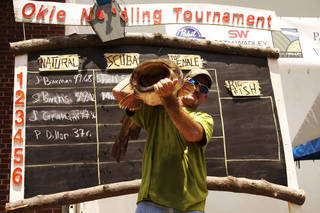 Scooter Bivins of Temple, one of the cast members of the cable television show Mudcats, holds up a flathead at the Okie Noodling Tournament in Pauls Valley. Photo provided
