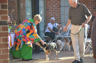 The Rev. Bertha Potts, senior minister, pets a dog walked by George Hedger Sept. 9 during the blessing of the animals at Edmond's First United Methodist Church. Photo by Ben Bigler, The Oklahoman Ben Bigler - The Oklahoman