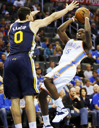 Oklahoma City's Reggie Jackson (15) shoots against Utah's Enes Kanter (0) during a preseason NBA basketball game between the Oklahoma City Thunder and the Utah Jazz at Chesapeake Energy Arena in Oklahoma City, Sunday, Oct. 20, 2013. Photo by Nate Billings, The Oklahoman