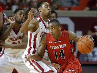 Texas Tech's Robert Turner (14) goes around Oklahoma's Isaiah Cousins (11) during an NCAA college basketball game between the University of Oklahoma and Texas Tech University at the Lloyd Noble Center in Norman, Okla., Wednesday, Feb. 12, 2014. Oklahoma lost 68-60. Photo by Bryan Terry, The Oklahoman