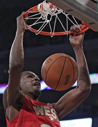 West's Kevin Durant, of the Oklahoma City Thunder, dunks during the first half of the NBA basketball All-Star Game on Sunday, Feb. 20, 2011, in Los Angeles. (AP Photo/Jae C. Hong)
