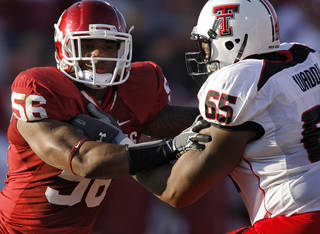 Oklahoma's Ronnell Lewis (56) takes on Texas Tech's LaAdrian Waddle (65) during the first half of the college football game between the University of Oklahoma Sooners (OU) and the Texas Tech Red Raiders (TTU) at the Gaylord Family Memorial Stadium on Saturday, Nov. 13, 2010, in Norman, Okla. Photo by Chris Landsberger, The Oklahoman