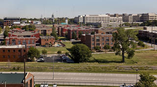 The empty lot just south of the Deep Deuce Apartments is set to become a six- to eight-story Marriott Springhill Suites. Photo by Chris Landsberger, The Oklahoman