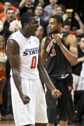 Oklahoma State guard Jean-Paul Olukemi celebrates after Texas Tech turned the ball over in a win against Texas Tech on Saturday, Feb 26, 2011. ZACH GRAY/Tulsa World