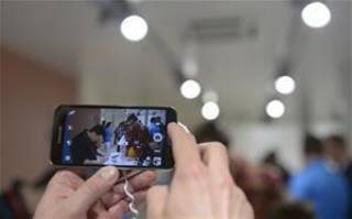 In this Feb. 25, 2014 file photo, the new Samsung Galaxy S5 is displayed at the Mobile World Congress, the world's largest mobile phone trade show in Barcelona, Spain. (AP Photo/Manu Fernandez, File)