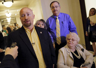Joe Dorman, a Democrat from Rush Springs, talks to reporters after he filed his papers to run for the office of governor at the State Capitol on Wednesday, April 9, 2014. Dorman's mother, Jan Dorman, lower right, came with her son to watch him file for the governor's race. Behind Dorman is his sister, Billie Coast and her husband. Photo by Jim Beckel, The Oklahoman