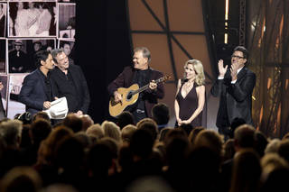 From left, Brad Paisley, Jimmy Webb, Glen Campbell, Glen's wife Kim, and Vince Gill, are seen onstage during a tribute to Glen Campbell at the 45th Annual CMA Awards in Nashville, Tenn., on Wednesday, Nov. 9, 2011. (AP Photo/Mark Humphrey) ORG XMIT: CASH288