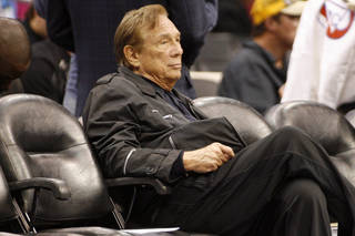 FILE - In this April 4, 2010, file photo, Los Angeles Clippers owner Donald Sterling sits courtside during the NBA basketball game between the New York Knicks and the in Los Angeles. NBA Commissioner Adam Silver Silver announced Tuesday, April 298, 2014, that Sterling has been banned for life by the league, in response to racist comments the league says he made in a recorded conversation.(AP Photo/Danny Moloshok, File)