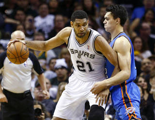 Oklahoma City's Steven Adams (12) defends San Antonio's Tim Duncan (21) during Game 2 of the Western Conference Finals in the NBA playoffs between the Oklahoma City Thunder and the San Antonio Spurs at the AT&T Center in San Antonio, Wednesday, May 21, 2014. Photo by Sarah Phipps, The Oklahoman