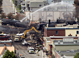 Searchers dig through the rubble for victims of an inferno July 8 in Lac-Megantic, Quebec, as firefighter continue to hose down tanker cars to prevent explosions. A runaway train derailed igniting tanker cars carrying crude oil early July 6. AP File Photo Ryan Remiorz - AP