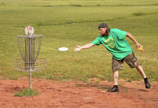 Kevin Custard plays disc golf during an April tournament at the Tye F. Cunningham Memorial Disc Golf Course at J.L. Mitch Park in Edmond. OKLAHOMAN ARCHIVE PHOTO