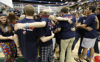 """FUNDRAISER / FUNDRAISING: Students hug and congratulate each other at the end of Double Wolf Dare Week in which students of Edmond Santa Fe High School in Edmond, OK, raised over $150,000 for the """"Warriors of Freedom"""" organization, Friday, March 1, 2013, By Paul Hellstern, The Oklahoman"""