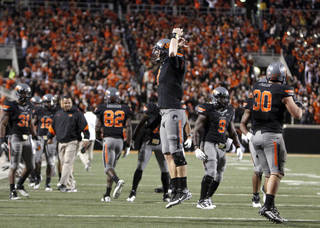 Oklahoma State's Brandon Weeden (3) celebrates Joseph Randle's winning touchdown during a college football game between the Oklahoma State University Cowboys (OSU) and the Kansas State University Wildcats (KSU) at Boone Pickens Stadium in Stillwater, Okla., Saturday, Nov. 5, 2011. Photo by Sarah Phipps, The Oklahoman