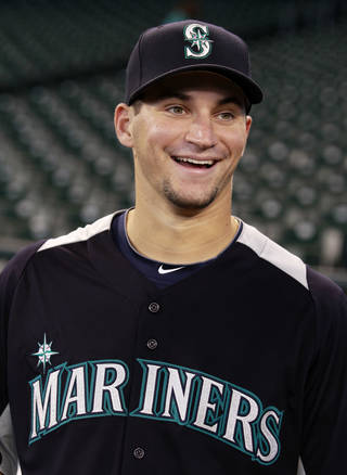MAJOR LEAGUE BASEBALL: Mike Zunino smiles as he stands on the field during the team warm-up Tuesday, July 3, 2012, before the Seattle Mariners' baseball game against the Baltimore Orioles in Seattle. Zunino was introduced by the Mariners a day after the team locked up the No. 3 overall pick in June's amateur draft. Zunino's trip to Seattle this time was brief and included taking in a couple of games at what he hopes is his home park someday and signing his contract. (AP Photo/Elaine Thompson) ORG XMIT: WAET101