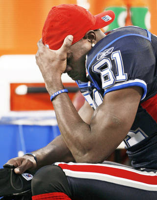 Buffalo wide receiver Terrell Owens reacts to the Bills' loss to New Orleans on Sunday. Owens failed to make a catch, ending his streak of games catching at least one pass at 185. AP PHOTO