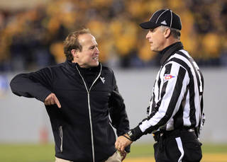 West Virginia coach Dana Holgorsen yells at an official during the third quarter of their NCAA college football game against Oklahoma in Morgantown, W.Va., on Saturday, Nov. 17, 2012. Oklahoma won 50-49. (AP Photo/Christopher Jackson)