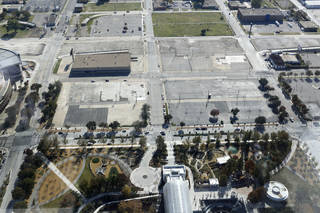 This photo looking south from Devon Tower shows the proposed site for the MAPS 3 convention center south of Myriad Gardens and west of Chesapeake Energy Arena. City officials hope to purchase the property, an old Ford dealership, in 2013, and advance the design process.