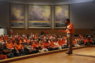 Mike Gundy, Oklahoma State head football coach, addresses the crowd during the OSU Cowboy Caravan at the National Cowboy and Western Heritage Museum Tuesday, August 5, 2014. Photo by Doug Hoke, The Oklahoman
