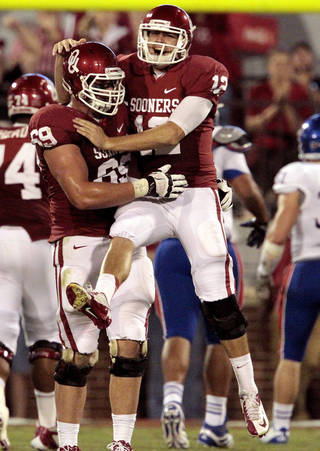 CELEBRATION: Landry Jones celebrates a touchdown throw with Lane Johnson (69) during the second half of the college football game where the University of Oklahoma Sooners (OU) defeated the University of Kansas Jayhawks (KU) 52-7 at Gaylord Family-Oklahoma Memorial Stadium in Norman, Okla., on Saturday, Oct. 20, 2012. Photo by Steve Sisney, The Oklahoman