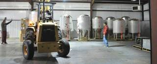 Workers move brewing equipment into Roughtail Brewing Co.'s brewhouse in Midwest City. The brewery moved its headquarters to Midwest City from Oklahoma City and now is using an online funding campaign to raise money for an automated canning line. Roughtail is one of two local breweries using the online tool. PHOTO PROVIDED BY ROUGHTAIL BREWING CO.