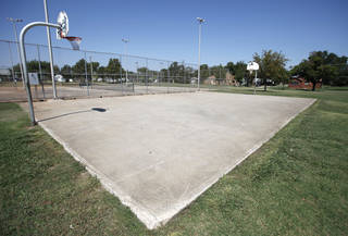 The Thunder's charity organization will pay to refurbish this basketball court at Pitts Park in northeast Oklahoma City. It's the second such court refurbishing by the team in Oklahoma City. Photo by Steve Gooch, The Oklahoman Steve Gooch