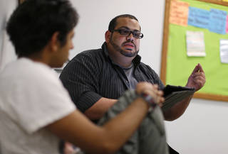 The Islamic Society of Greater Oklahoma's new youth director Abdur-Rahman Taleb talks to a group of youths at the Mercy School complex, 14001 N Harvey. BRYAN TERRY - THE OKLAHOMAN